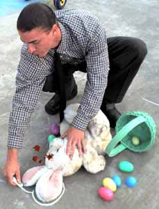 Coroner Timothy Lang chalks the body of The Easter Bunny.