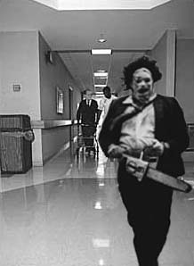 "Leatherface flees orderlies, who allegedly attempted to confiscate his chainsaw, screaming, ""It's family, it's family!"" in protest."